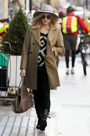 Fearne stayed wrapped up and warm in a classic camel pea coat.