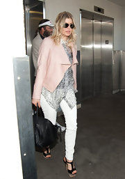 Fergie looked ready for spring in a pale pink jacket and skinny white jeans.