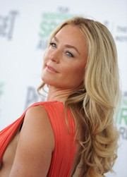 Elisabeth Rohm left her hair loose with a center part and curly ends when she attended the Film Independent Spirit Awards.