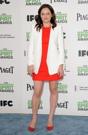 Elisabeth Moss was all business in a white Chloe blazer layered over a red Alexander McQueen dress during the Film Independent Spirit Awards.