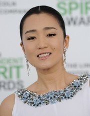 Gong Li slicked her hair back into a center-parted bun for the Film Independent Spirit Awards.