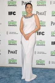 Gong Li went for simple elegance at the Film Independent Spirit Awards in a white column dress with an embellished neckline.