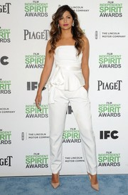 Camila Alves looked fierce on the blue carpet in a strapless white peplum jumpsuit by Juan Carlos Obando during the Film Independent Spirit Awards.