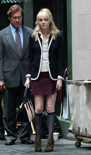 Emma Stone chose a navy blazer with white trim for her adorable mod-inspired look on 'The Amazing Spider Man 2' set.