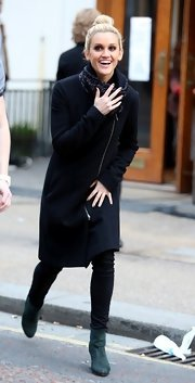 Ashley Roberts chose a structured wool coat with a streamline shape and front zipper for her look while filming 'Saturday Night Takeaway.'