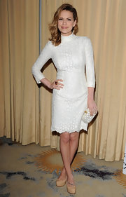Bethany Joy Galeotti mirrored the dotted print of her white dress with a matching box clutch.