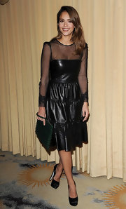 Jessica Alba matched the tough-chic vibe of her leather dress with a green studded clutch.