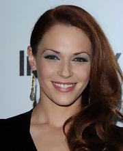 Amanda Righetti wore a pair of statement-making gold and silver earrings at the Forevermark and 'InStyle' Golden Globe Awards event.