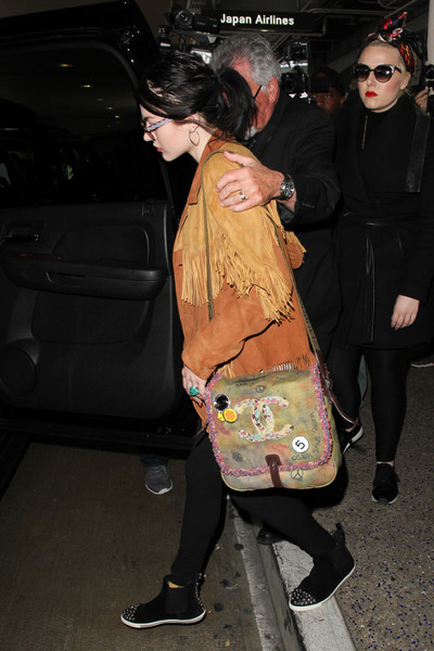 Frances Bean Cobain arrived at LAX carrying a grunge-chic Chanel messenger bag.