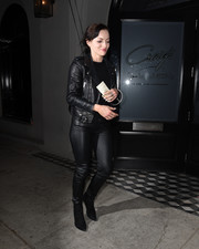 Francesca Eastwood sealed off her ultra-edgy look with black suede ankle boots.