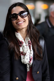 Freida Pinto looked super glam while walking through the Toronto Airport. To keep longer lengths sleek and healthy, try a conditioning product like ALTERNA Bamboo Smooth Kendi Oil Dry Mist.