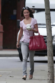 While going on a coffee run in Chelsea, Pippa Middleton added a splash of color to her luck with a cherry leather tote with silver hardware.