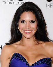 Joyce Giraud chose a simple and sleek 'do to show off her dark layered locks.