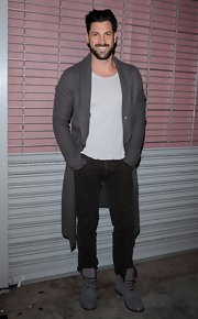 Maksim Chmerskiy wore a long cardigan to the GLOW BIO opening in West Hollywood.