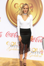 Nastia Liukin dressed up her top with a black lace-hem pencil skirt.