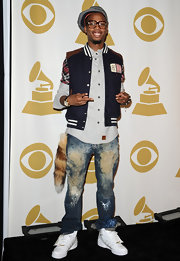 B.o.B paired his Letterman jacket and white sneakers with distressed jeans.