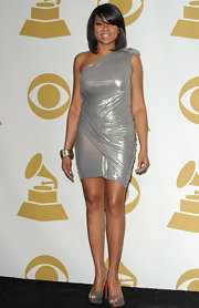 Taraji P. Henson was a metallic maven at the Grammy Nominations concert. She paired her look with sparkling platform peep-toe pumps.