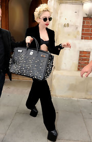 Lady Gaga decked out another one of her expensive tote bags with studs. Wonder if she did it herself.