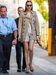 Gal Gadot displayed her mile-long legs in a short beige trenchcoat while making her way to 'Kimmel.'