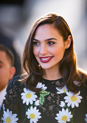Gal Gadot amped up the girly appeal with a berry lip.