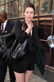 Gemma Arterton carried an oversized black patent-leather satchel while traveling to the BBC Studios.