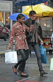 Genevieve Jones wore pretty floral embellished flats while walking in the rain in Soho