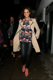 Alesha Dixon added feminine color to her ensemble with a pair of pink peep-toe ankle boots.