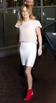 Geri's white bandage skirt kept her muted ensemble sleek so her sassy ankle booties could pop.