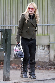 Geri Halliwell stowed her daughter's darling stuffed animal in her black leather bag.