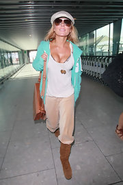 Geri Halliwell wore a pair of classic aviator sunglasses with brown lenses while traveling through the Heathrow Airport.