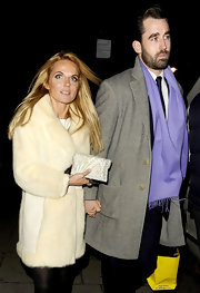 Geri Halliwell added a glitzy touch to her bundled up style with a silver beaded clutch.