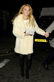 Former Spice Girl Geri Halliwell bundled up in a cream fur coat.
