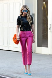 Gigi Hadid was spotted at a photoshoot in New York City wearing a shiny black T-shirt.
