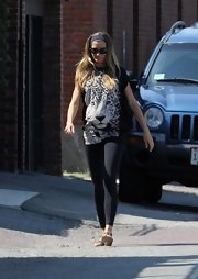 Gisele covered up her baby bump with an oversized cheetah graphic tee.