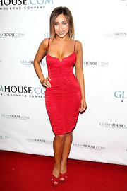 Korrina Rico topped off her ruched cocktail dress with red platform sandals.