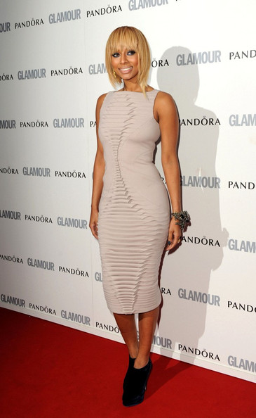 Keri wore a nude bandage dress with a scale texture for the Glamour Women of the Year Awards.
