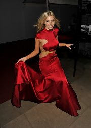 Mollie King chose a crimson illusion dress for her red carpet look at the 'Glamour' Women of the Year Awards.