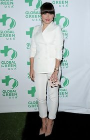 Sophia Bush chose a crisp white pantsuit for her look on the 'green carpet' at the Global Green pre-Oscar party.