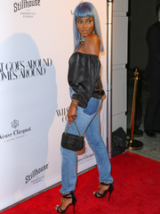 Keke Palmer attended the opening of What Goes Around Comes Around carrying a black chain-strap bag by Chanel.