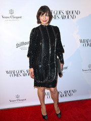 Milla Jovovich matched her frock with a pair of studded platform pumps.