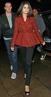 Selena Gomez looked darling in an orange tweed coat with a peplum waist.