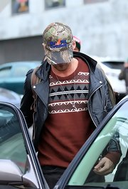 Ryan Gosling tried to maintain a low profile by keeping his face hidden under a printed baseball cap.