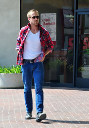 Ryan Gosling kept it casual in an unbuttoned flannel shirt as he left a branch of Bank of America.