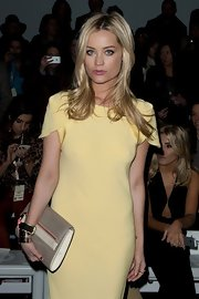 Laura Whitmore attended the Grachvogel fashion show carrying a stylish taupe patent leather clutch.