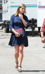 Ashley showed off some curves with this navy shirtdress.