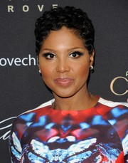 Toni Braxton wore her hair in short curls at the Grove's Christmas Tree Lighting Spectacular.