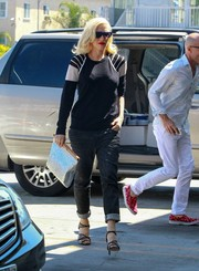 Gwen Stefani continued the black-and-white motif with a pair of L.A.M.B. strappy sandals.