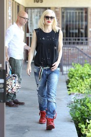 Gwen Stefani stepped out looking super rugged in a tattered tank and jeans, punctuated with a pair of red BBC x Timberland combat boots.