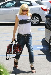 Gwen Stefani continued the black, white, and red theme with an abstract-print bowler bag.