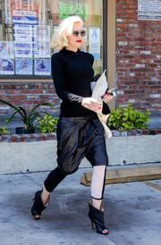 Gwen Stefani was her usual cool self in black drop-crotch leather shorts by R13 layered over monochrome leggings while out running errands.